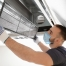 Technician Remove Air Filter